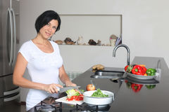 Housewife making fresh salad Stock Images
