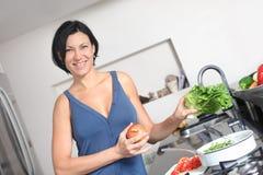 Housewife making fresh salad Royalty Free Stock Photo