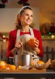 Housewife making homemade orange marmalade in Christmas kitchen Stock Photo