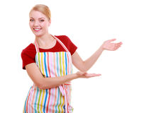 Housewife making inviting welcome gesture Stock Photos