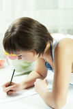 Housewife making notes closeup Stock Photo