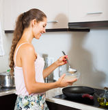 Housewife making pancakes on pan Stock Photography