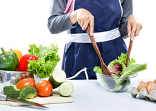 Housewife making salad for dinner Royalty Free Stock Image