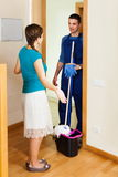 Housewife meeting handsome cleaner Stock Photos