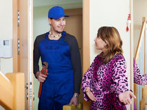 Housewife meeting service worker at home Royalty Free Stock Photo