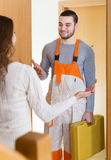 Housewife meeting workman Royalty Free Stock Photo