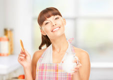Housewife with milk and cookies Royalty Free Stock Images