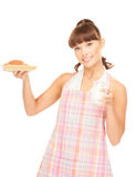Housewife with milk and cookies Royalty Free Stock Image