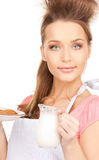 Housewife with milk and cookies Stock Photography