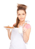 Housewife with milk and cookies Stock Images