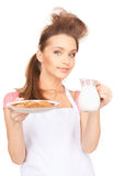 Housewife with milk and cookies Royalty Free Stock Photo