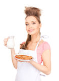 Housewife with milk and cookies Stock Photo