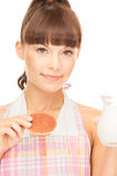 Housewife with milk and cookies Royalty Free Stock Photography