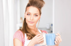 Housewife with milk and mug Stock Photos