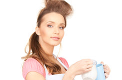 Housewife with milk and mug Royalty Free Stock Images