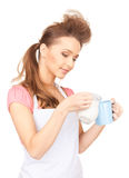 Housewife with milk and mug Stock Images