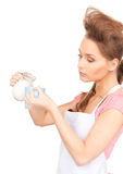Housewife with milk and mug Royalty Free Stock Photo