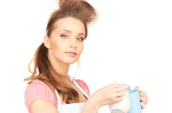 Housewife with milk and mug Royalty Free Stock Photos