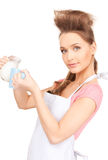 Housewife with milk and mug Stock Photography