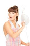 Housewife with mixer Stock Photo
