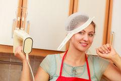 Housewife with mixer having fun in kitchen. Stock Image