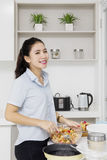 Housewife mixing apple and sugar in bowl Royalty Free Stock Photography