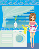 Housewife in modern blue kitchen Stock Photography