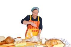 Housewife molding dough Stock Photos