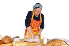 Housewife molding dough Stock Image