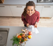 Housewife with money and grocery shopping Royalty Free Stock Image