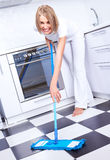Housewife with a mop Royalty Free Stock Photo