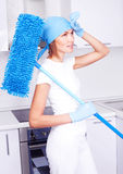 Housewife with a mop Stock Photos