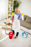 Housewife with mop and chemical house products posing Stock Photo