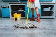 Housewife mopping floor. Low section of housewife mopping floor in kitchen Stock Photo