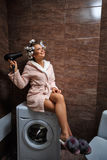 Housewife in morning in bathroom Stock Photography