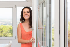Housewife near window Royalty Free Stock Image