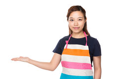 Housewife with open hand palm Royalty Free Stock Photos