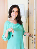 Housewife open new lock of door Royalty Free Stock Photography