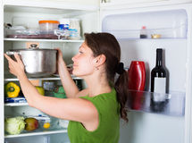 Housewife opening refrigerator at  kitchen Royalty Free Stock Photos