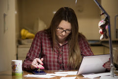 Housewife paying bills online Stock Image