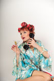 Housewife on the phone Royalty Free Stock Image
