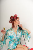 Housewife on the phone. Housewife speaking on the phone with her friends stock image
