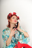 Housewife on the phone. Housewife speaking on the phone with her friends royalty free stock photography