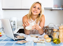 Housewife planning to spend money Royalty Free Stock Photo