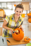 Housewife prepare big orange pumpkin for Halloween party Royalty Free Stock Photography