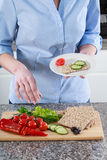 Housewife preparing a healthy sandwich Stock Image