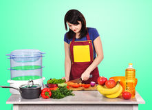 Housewife preparing a meal Royalty Free Stock Images