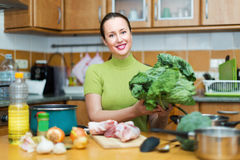 Housewife preparing meal in kitchen Stock Image