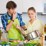Housewife put too much spices in food Stock Image