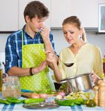 Housewife put too much spices in food Stock Photography